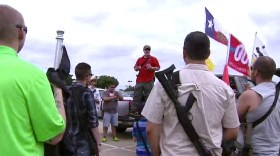 Men armed with semiautomatic weapons in a Target parking lot, Irving, Texas, 2014. Irving is the Dallas suburb in which Ahmed Muhammad was detained yesterday after a teacher was afraid his electronics project was a bomb. Screen shot from KDAF-TV.